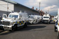 Press Eye - Belfast - Northern Ireland  - 12th July 2017 - . PSNI land rovers parked up as bandsmen and members of the Orange Order march down the Crumlin Road, past Ardoyne shops, in North Belfast after a deal was struck last year between the Orange Order and the Ardoyne Residents Association. . Orangemen from across Northern Ireland will rake part in the annual commemoration of William of Orange\'s victory over King James II at the Battle of the Boyne in 1690.. Photo by Kelvin Boyes / Press Eye..