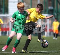 ©/Presseye.com - 17th July 2017.  Press Eye Ltd - Northern Ireland - Hughes Insurance Foyle Cup 2017- Mini Soccer U-10 - Kick Start (Derry) V Illies Celtic (Donegal). Kick Start\'s Jack O\'Donnell and Illies Andrew Doherty..  . Mandatory Credit Photo Lorcan Doherty / Presseye.com