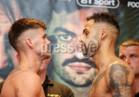 Press Eye - Belfast - Northern Ireland - 29th June 2018. Weigh in at the Europa Hotel in Belfast ahead of Michael Conlan\'s homecoming fight against Brazilian Adeilson Dos Santos at the SSE Arena on Saturday night. . Left to right.  Lewis Benson and Johnny Coyle go head-to-head after the weigh in. . Picture by Jonathan Porter/PressEye