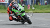 Mandatory Credit: Rowland White/Presseye. Motor Cycle Racing: Tandragee 100. Venue: Tandragee. Date: 05th April 2012. Caption: Ryan Farquhar gets down to it on his 450cc Kawasaki
