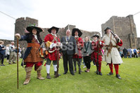 Press Eye - Belfast - Northern Ireland  - 13th July 2017 - . Paul Reid, Mayor of Mid and East Antrim and  Deputy Mayor Cheryl Johnston, with some of the actors who took part of  the re-enactment of the Siege of Carrickfergus Castle and the landing of King William at Castle Green, Carrickfergus. The event included re-enactment groups from across the Northern Oteland, all dressed in period costume followed by a Pageantry parade to meet King William upon his landing at Carrick Harbour. . Photo by Kelvin Boyes / Press Eye..