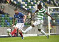 Press Eye - Belfast - Northern Ireland -14th July. Photo by Stephen Hamilton  / Press Eye.. Champions league qualifying match first leg between Linfield and Celtic at Windsor park in Belfast.. Linfields Mark Stafford  in action with Celtics Moussa Dembele.