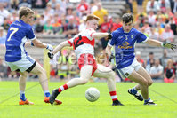 PressEye - Belfast - Northern Ireland - 16th July 2017. Ulster Minor Football Championship Final. Derry v Cavan. Pictured: Cavan\'s Danny Cusack and Kevin Hendrick and Derry\'s Declan Cassidy.. Picture: Philip Magowan / PressEye