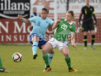 Press Eye - Belfast - Northern Ireland - 8th June. World Cup qualifier - Northern Ireland  v Netherlands at Shamrock Park Portadown.. Northern Irelands Caragh Milligan  in action with Netherlands Sherida Spitse. Mandatory Credit: Presseye/Stephen Hamilton