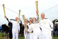©Press Eye Ltd Northern Ireland - 7th June 2012. Mandatory Credit - Picture by Darren Kidd/Presseye.com . Larne Borough Council and the Borough\'s six local torch bearers bid the Olympic torch farewell from the Port of Larne as the Northern Ireland leg of the London 2012 relay concluded yesterday. Pictured are from L-R Trevor Ringland, Dianne McMillan, Dawn Aston, Nicola Blythe, Kate Irvine and David Boyle.  .  .