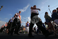 Press Eye - Belfast - Northern Ireland  - 12th July 2017 - . Bandsmen and members of the Orange Order march down the Crumlin Road, past Ardoyne shops, in North Belfast after a deal was struck last year between the Orange Order and the Ardoyne Residents Association. . Orangemen from across Northern Ireland will rake part in the annual commemoration of William of Orange\'s victory over King James II at the Battle of the Boyne in 1690.. Photo by Kelvin Boyes / Press Eye..