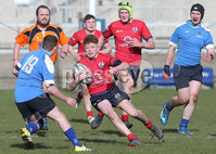 Press Eye Belfast - Northern Ireland 14th March 2019. Danske Bank U16High Schools Trophy Final. Craigavon High School(red) Vs Ballyclare Secondary School. . Craigavon\'s Jamie Hayes pushes forward against Ballyclare\'s Tyler Murdock.. Picture by Jonathan Porter/PressEye.com