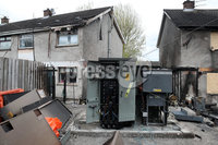 Press Eye - Birchmount Arson Attack - 14th April 2019. Photograph by Declan Roughan. Detectives are investigating a suspected arson attack in Birchmount in Newtownabbey on Saturday 13 April.. The blaze, which completely gutted one house and damaged another, was reported to police at around 2pm by colleagues in the Northern Ireland Fire and Rescue Service. It is their assessment that a recycling bin to the rear of the houses was set alight and the flames then spread to the homes. Two vehicles parked outside were also extensively damaged.. Detectives are working to establish a motive and are appealing for witnesses or anyone with information to get in touch on 101, quoting reference 675 13/04/19.