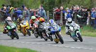 Mandatory Credit: Rowland White/Presseye. Motor Cycle Racing: Tandragee 100. Venue: Tandragee. Date: 05th April 2012. Caption: Start of the 125cc race with Paul Robinson (18) and Sam Wilson (56) out front