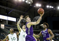 Press Eye - Belfast -  Northern Ireland - 01st December 2017 - Photo by William Cherry/Presseye. Manhattan College\'s Nehemiah Mack and Zane Waterman with Holy Cross\'s Matt Zignorski during Friday afternoons Basketball Hall of Fame Belfast Classic game at the SSE Arena, Belfast.