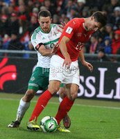 PressEye-Northern Ireland- 12th November  2017-Picture by Brian Little/ PressEye. Switzerland Fabian Schar    and Northern Ireland  Conor Washington   during Sunday night\'s FIFA  World Cup play-off  second leg match at St Jacob Park, Basel.. Picture by Brian Little/PressEye