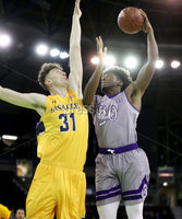 Press Eye - Belfast -  Northern Ireland - 02nd December 2017 - Photo by William Cherry/Presseye. La Salle University\'s Cian Sullivan with College of the Holy Cross\'s Jehyve Floyd during Saturday afternoons Basketball Hall of Fame Belfast Classic game at the SSE Arena, Belfast.  Photo by William Cherry/Presseye