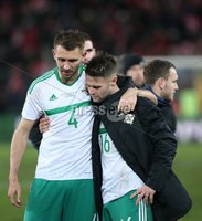 PressEye-Northern Ireland- 12th November  2017-Picture by Brian Little/ PressEye. Dejected  Northern Ireland Gareth McAuley and Oliver Norwood  after the final whistle against Switzerland   during Sunday night\'s FIFA  World Cup play-off  second leg match at St Jacob Park, Basel.. Picture by Brian Little/PressEye