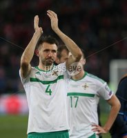 PressEye-Northern Ireland- 12th November  2017-Picture by Brian Little/ PressEye. Dejected  Northern Ireland Gareth McAuley   after the final whistle against Switzerland   during Sunday night\'s FIFA  World Cup play-off  second leg match at St Jacob Park, Basel.. Picture by Brian Little/PressEye