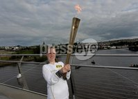 Presseye Northern Ireland - 04th June 2012 Mandatory Credit - Photo-William Cherry/Presseye. Olympic Torchbearer Meabh Fischer  in the middle of the Peace Bridge in Derry during the Olympic Torch relay.