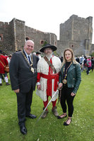 Press Eye - Belfast - Northern Ireland  - 13th July 2017 - . Paul Reid, Mayor of Mid and East Antrim and  Deputy Mayor Cheryl Johnston, with Boyd Rankin who took part of  the re-enactment of the Siege of Carrickfergus Castle and the landing of King William at Castle Green, Carrickfergus. The event included re-enactment groups from across the Northern Oteland, all dressed in period costume followed by a Pageantry parade to meet King William upon his landing at Carrick Harbour. . Photo by Kelvin Boyes / Press Eye..