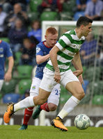 Press Eye - Belfast - Northern Ireland -14th July. Photo by Stephen Hamilton  / Press Eye.. Champions league qualifying match first leg between Linfield and Celtic at Windsor park in Belfast.. Linfields Robert Garrett  in action with Celtics Tom Rogic.
