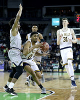 Press Eye - Belfast -  Northern Ireland - 01st December 2017 - Photo by William Cherry/Presseye. La Salle University\'s Pookie Powell with Towson College\'s Brian Starr during Friday evenings Basketball Hall of Fame Belfast Classic game at the SSE Arena, Belfast.
