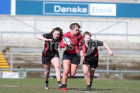 Press Eye Belfast - Northern Ireland 14th March 2019. Danske Bank Ulster Schools Girls X7s Senior Cup Final. Enniskillen Royal Grammar School(in red) vs Loreto Secondary School Letterkenny.. Enniskillen\'s India Daley pushes forward against Loreto\'s LEAH GALLAGHER(left) and MAIREAD MC GETTIGAN. . Picture by Jonathan Porter/PressEye.com