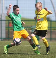 ©/Presseye.com - 9th July 2017.  Press Eye Ltd - Northern Ireland - Hughes Insurance Foyle Cup 2017- Mini Soccer U-10 - Clonmany Sdhamrocks (Donegal) V Aileach FC (Donegal). Aileach Shane Clarke-Doherty  denies Clonmany Shamrock\'s MGavin Friel..  . Mandatory Credit Photo Lorcan Doherty / Presseye.com