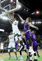 Press Eye - Belfast -  Northern Ireland - 01st December 2017 - Photo by William Cherry/Presseye. Manhattan College\'s Ebube Ebube with Holy Cross\'s Austin Butler during Friday afternoons Basketball Hall of Fame Belfast Classic game at the SSE Arena, Belfast.