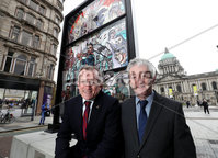 Press Eye - Belfast -  Northern Ireland - 15th April 2019 - Photo by William Cherry/Presseye.  . New Tourism Ireland campaign will encourage fans to make a pilgrimage to Belfast, where much of the world's most popular TV show was filmed ~.  . A giant, stained glass window was unveiled today in front of Belfast City Hall. The impressive installation is part of Tourism Ireland's brand new Glass of Thrones campaign – to showcase and celebrate . Northern Ireland as Game of Thrones Territory to millions of fans worldwide. This is the first of six installations to be unveiled over the coming weeks..  . PIC SHOWS: Niall Gibbons, CEO of Tourism Ireland; and John McGrillen, CEO of Tourism NI, in front of a stained glass window opposite the main entrance of Belfast City Hall – at the launch of Tourism Ireland's 2019 Game of . Thrones campaign..  . Pic – Will Cherry/Presseye (no repro fee).  . Further press info: Sinead Doyle, MCE Public Relations tel: 079 1205 9230 OR Elaine Moore / Clair Balmer, Tourism Ireland tel: 077 6652 7719