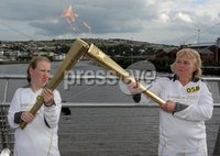 Presseye Northern Ireland - 04th June 2012 Mandatory Credit - Photo-William Cherry/Presseye. Olympic Torchbearers Meabh Fischer and Isabella Coote in the middle of the Peace Bridge in Derry during the Olympic Torch relay.