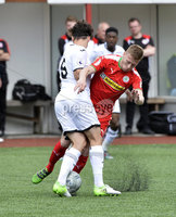 Press Eye - Belfast - Northern Ireland -15th July. Photo by Stephen Hamilton  / Press Eye.. Pre season friendly match between Cliftonville and Swansea u23 at Solitude in Belfast.. Cliftonvilles Stevie Garrett  in action with Swansea\'s Jack Evans