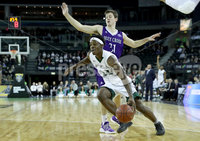 Press Eye - Belfast -  Northern Ireland - 01st December 2017 - Photo by William Cherry/Presseye. Manhattan College\'s Aaron Walker with Holy Cross\'s Matt Zignorski during Friday afternoons Basketball Hall of Fame Belfast Classic game at the SSE Arena, Belfast.