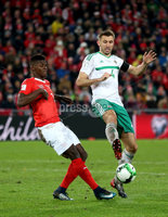 Press Eye - Belfast -  Northern Ireland - 12th November 2017 - Photo by William Cherry/Presseye. Northern Ireland\'s Gareth McAuley with Switzerland\'s Breel Embolo during Sunday nights World Cup Play Off 2nd leg game at St. Jakob-Park, Basel.