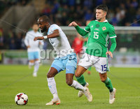 Press Eye Belfast - Northern Ireland 11th September 2018. International Challenge match at the National Stadium at Windsor Park in Belfast.  Northern Ireland Vs Israel. . Northern Ireland\'s Jordan Jones with Israel\'s Eli Dasa. Picture by Jonathan Porter/PressEye.com