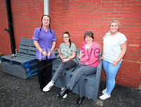 Press Eye Belfast - Northern Ireland 17th May 2017. Ahead of June Westminster election DUP leader Arlene Foster visits several projects in east Belfast.  . Arlene Foster(second from right) pictured with (L-R) Debbie McCaughey, Danielle McCord and Karla Holmes from the Women\'s Shed Group at the Ballymac Friendship Trust with some of the pallet furniture they have built. . Picture by Jonathan Porter/PressEye.com.