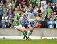 8th August 2018. Northern Ireland v Bosnia & Herzegovina at the national stadium in Belfast.. Northern Ireland\'s Conor McLaughlin  in action with  Bosnia & Herzegovina\'s Edin Dzeko.  Mandatory Credit: Stephen Hamilton /Presseye