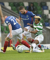 Press Eye - Belfast - Northern Ireland -14th July. Photo by Stephen Hamilton  / Press Eye.. Champions league qualifying match first leg between Linfield and Celtic at Windsor park in Belfast.. Linfields Mark Stafford  in action with Celtics Scott Sinclair.