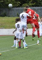 Press Eye - Belfast - Northern Ireland -15th July. Photo by Stephen Hamilton  / Press Eye.. Pre season friendly match between Cliftonville and Swansea u23 at Solitude in Belfast.. Cliftonvilles Garry Breen heads his side into a 2-1 lead