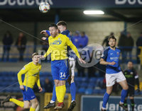 Tennants Irish Cup at Mourneview in Lurgan.  11.02.2019. Glenavon v Dungannon. Glenavon\'s James Singleton with Dungannon\'s Michael Carville. Mandatory CreditINPHO/PressEye.com/Jonathan Porter.
