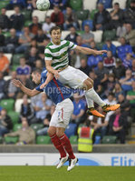 Press Eye - Belfast - Northern Ireland -14th July. Photo by Stephen Hamilton  / Press Eye.. Champions league qualifying match first leg between Linfield and Celtic at Windsor park in Belfast.. Linfields Andy Waterworth   in action with Celtics Erik Sviatchenko