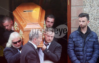 Press Eye - Belfast - Northern Ireland - 11th July 2018. Funeral for road racer William Dunlop at Garryduff Presbyterian Church outside Ballymoney in Co. Antrim.  The 32-year-old was killed while participating in the practise session of the Skerries 100 in Co. Dublin lat Saturday.  William\'s father Robert was also buried from Garryduff Presbyterian Church when he died at the North West 200 road race in 2008.. William Dunlop\'s family, including his brother Michael(back right) carry his coffin from the church after the funeral service as fellow road racer Glenn Irwin looks on. . Picture by Jonathan Porter/PressEye