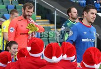 Danske Bank Premiership, Windsor Park, Belfast 2/12/2017. Linfield vs Dungannon Swifts. Linfield\'s Roy Carroll and Mark Haughey are greeted onto the pitch by a junior football team wearing Santa hats before the match. Mandatory Credit @INPHO/Brian Little