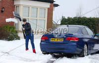 Press Eye - Belfast - Northern Ireland - 4th March 2018. As the snow in Northern Ireland begins to clear Oliver Watson(12) digs out a car in the Fourwinds area of south Belfast. . Picture by Jonathan Porter/PressEye