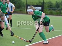 Mandatory Credit: Rowland White/Presseye. Women\'s Hockey: Friendly. Teams: Ireland (green) v Scotland (white). Venue: Lisnagarvey. Date: 27th June 2012. Caption: Naomi Carroll, Ireland