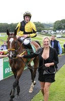 Press Eye - Belfast - Northern Ireland - 13th July 2017 . Downpatrick racecourse family fun race day.. A J C Group Hurdle of €15,000.00. Race winner Mr Showtime with jockey Sean Flanagan jockey and Asia Gajda (black dress).. Picture by Matt Mackey / presseye.com.