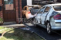 Press Eye © Belfast - Northern Ireland. Photo by Freddie Parkinson / Press Eye ©. Sunday 10 September 2017. A house has been badly damaged and two cars destroyed in an arson attack in Larne, County Antrim.. The two cars were set alight in the driveway of the house in Magee Park shortly after 03:00 BST on Saturday.. The fire also damaged the house. The occupants of the house were told to stay at the back of it while firefighters put the blaze out.. Police have appealed for anyone who saw any suspicious activity in the area to contact them.