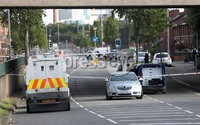 Press Eye - Security Alert North Queen Street - 12th September 2017. Photograph by Declan Roughan. A number of homes have been evacuated and motorway traffic has been affected by a security alert in Belfast.. The alert began on North Queen Street during the early hours of Tuesday and police and Army bomb disposal officers attended the scene.. A robot was deployed to investigate an object on the road and officers examined a grey car.. The vehicle has broken windows and has been daubed with white paint.