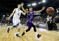 Press Eye - Belfast -  Northern Ireland - 01st December 2017 - Photo by William Cherry/Presseye. Manhattan College\'s Zane Waterman with Holy Cross\'s Patrick Benzan during Friday afternoons Basketball Hall of Fame Belfast Classic game at the SSE Arena, Belfast.