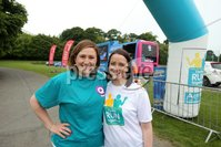 Press Eye - Belfast - Northern Ireland - 5th June 2016 - . Cate Conway and Jennifer Morton part in the first ever Centra 5k pairs run for Action Cancer at Ormeau Park.. Over 100 families, friends and colleagues paired up today (Sunday 5th June) for the inaugural Centra Run Together event at Ormeau Park, raising vital funds for local charity Action Cancer. . Run Together is a set of four 5k races taking place across Belfast, Mid Ulster and Derry between June and October which encourage you to run with your partner, son, daughter, friend or neighbour. . Picture by Kelvin Boyes / Press Eye . .