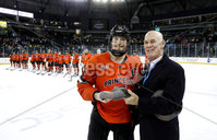 Press Eye - Belfast, Northern Ireland - 30th November 2019 - Photo by William Cherry/Presseye. Ralph Cox presents Princeton Tigers\' Derek Topatigh with the man of the game award during Saturday afternoons Friendship Four game against UNH Wildcats at the SSE Arena, Belfast.      Photo by William Cherry/Presseye