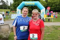 Press Eye - Belfast - Northern Ireland - 5th June 2016 - . Danielle McLaughlin from Whitehead and Sandra Mogey from Carrick  take part in the first ever Centra 5k pairs run for Action Cancer at Ormeau Park.. Over 100 families, friends and colleagues paired up today (Sunday 5th June) for the inaugural Centra Run Together event at Ormeau Park, raising vital funds for local charity Action Cancer. . Run Together is a set of four 5k races taking place across Belfast, Mid Ulster and Derry between June and October which encourage you to run with your partner, son, daughter, friend or neighbour. . Picture by Kelvin Boyes / Press Eye . .