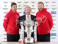Press Eye Northern Ireland . Thursday 6th December 2018. Picture by Jonathan Porter  / Press Eye . . 5th Round Draw of the Tennent\'s Irish Cup that took place today in Pat Jennings Lounge, National Football Stadium at Windsor Park.. . Larne first team coach Tim McCann is flanked by Larne players Chris Ramsey and Conor Devlin at the Tennents Irish Cup fifth round draw. Larne will face Premiership side Newry City at Inver Park in round five on Saturday 5 January.