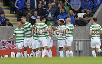 Press Eye - Belfast - Northern Ireland -14th July. Photo by Stephen Hamilton  / Press Eye.. Champions league qualifying match first leg between Linfield and Celtic at Windsor park in Belfast.. Celtics players celebrate after Rogic made it 2-0 on the night.